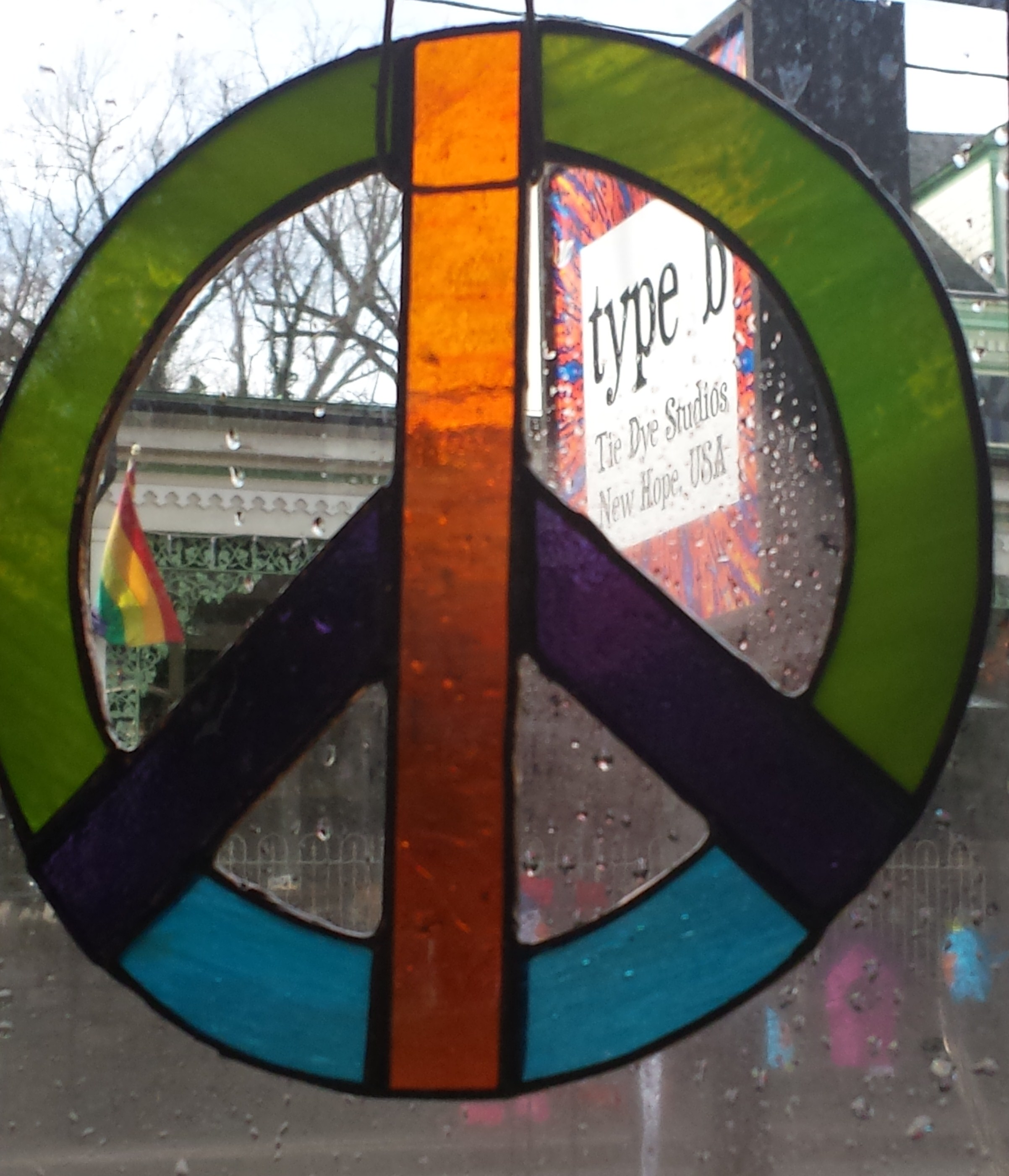 New Hope stained glass Peace Signs